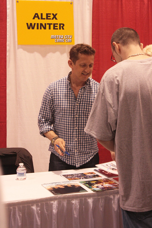 """. \""""Bill & Ted\"""" actor Alex Winter gets ready to sign a photo for a fan. (Photo by Erica McClain)"""