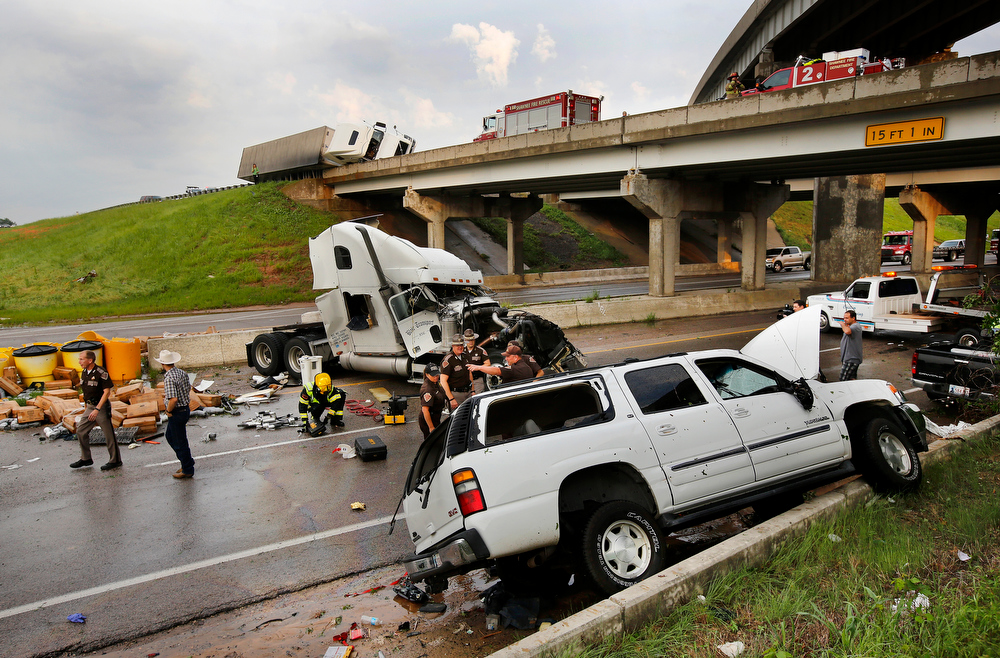 Description of . A tornado caused extensive damage along I-40 at the junction with  US 177 on the west side of Shawnee, Okla., Sunday evening,  May 19,  2013. (AP Photo/The Oklahoman, Jim Beckel)