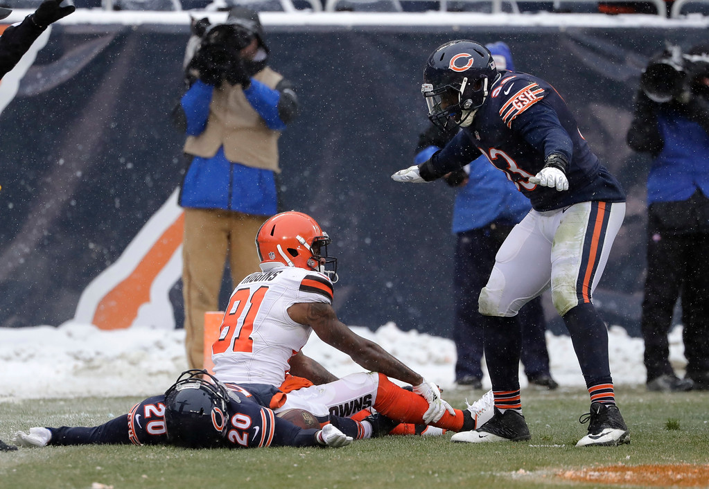. Chicago Bears cornerback Prince Amukamara (20) lies in the end zone after recovering a Cleveland Browns wide receiver Rashard Higgins (81) fumble after a pass reception as Sam Acho (93) reacts in the second half of an NFL football game in Chicago, Sunday, Dec. 24, 2017. (AP Photo/Nam Y. Huh)