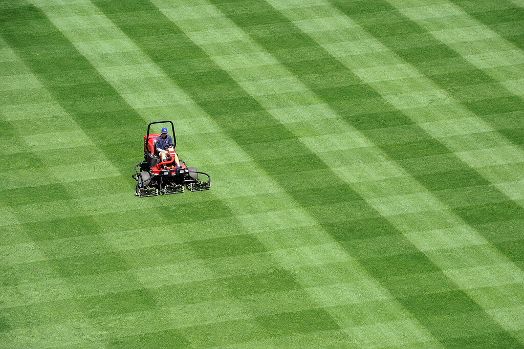 . Dodger Stadium grounds crew member Rob Sedlak prepares the field for the Opening Weekend series with the Giants Thursday April 3, 2014.(Andy Holzman/Los Angeles Daily News)