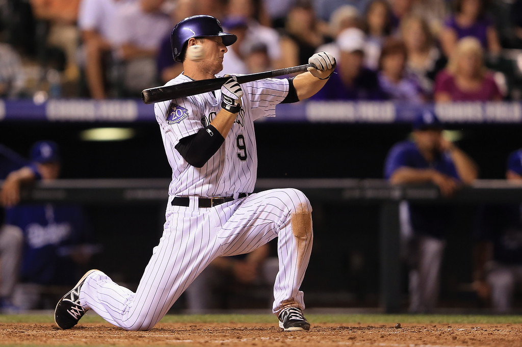 . DJ LeMahieu #9 of the Colorado Rockies attempts to bunt and dodges an inside pitch from Paco Rodriguez #75 of the Los Angeles Dodgers in the eighth inning at Coors Field on September 3, 2013 in Denver, Colorado.  (Photo by Doug Pensinger/Getty Images)