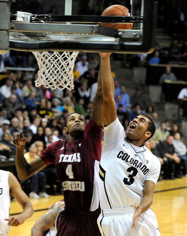 . University of Colorado\'s Xavier Talton goes for a layup over Fred Sturdivant during a game against Texas Southern on Tuesday, Nov. 27, at the Coors Event Center on the CU campus in Boulder.  Jeremy Papasso/ Camera