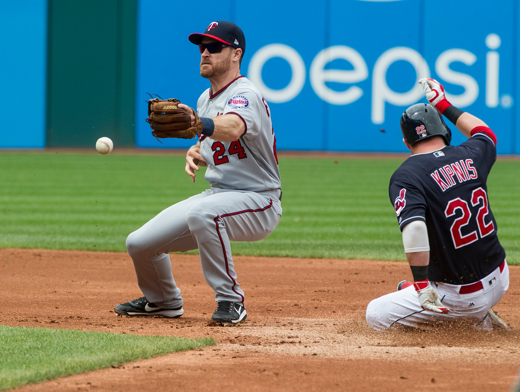 . Minnesota Twins\' Logan Forsythe (24) bobbles the ball as Cleveland Indians\' Jason Kipnis (22) slides safely into second with a double during the third inning of a baseball game in Cleveland, Thursday, Aug. 30, 2018. (AP Photo/Phil Long)