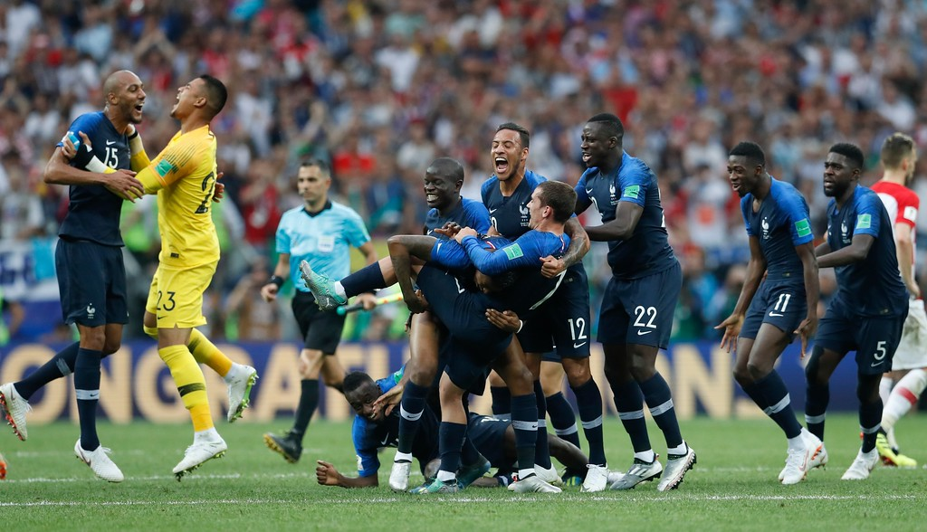 . French players celebrate at the end of the final match between France and Croatia at the 2018 soccer World Cup in the Luzhniki Stadium in Moscow, Russia, Sunday, July 15, 2018. France won 4-2. (AP Photo/Petr David Josek)