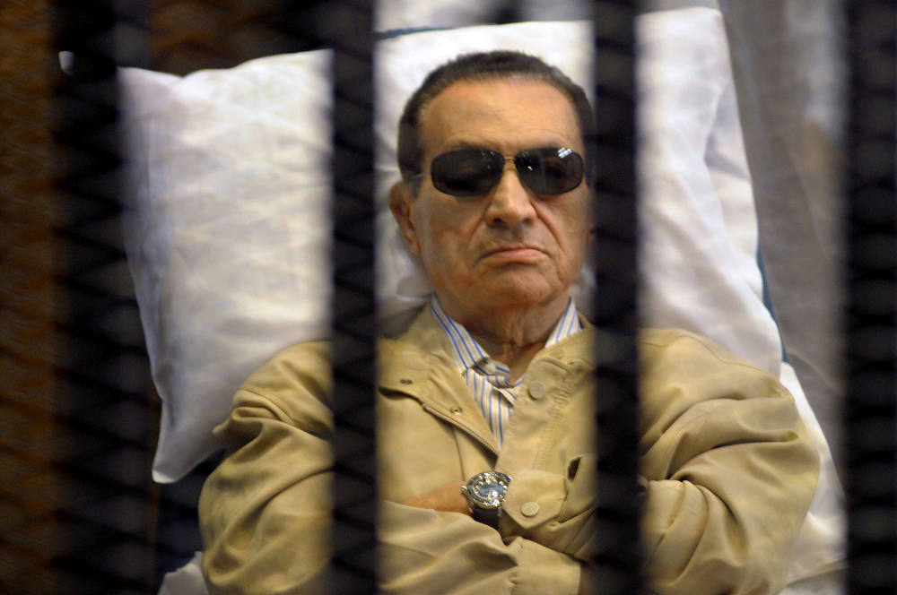 Description of . Ousted Egyptian president Hosni Mubarak sits inside a cage in a courtroom during his verdict hearing in Cairo on June 2, 2012. A judge sentenced Mubarak to life in prison after convicting him of involvement in the murder of protesters during the uprising that ousted him last year. AFP PHOTO/STRSTR/AFP/Getty Images