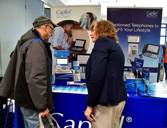 4/6/2019 Mike Orazzi | Staff Captel's Kim Schmidt talks with Archie Ruel during the 5th Annual Connecticut Prime Time Senior Fair Saturday at Bristol Eastern High School.
