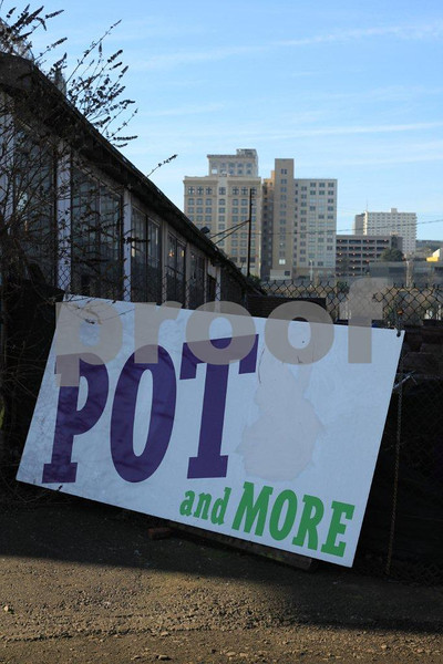 A POT sign with the skyline of Tacoma, WA in the background.  In this case, POT means clay pots for plants.