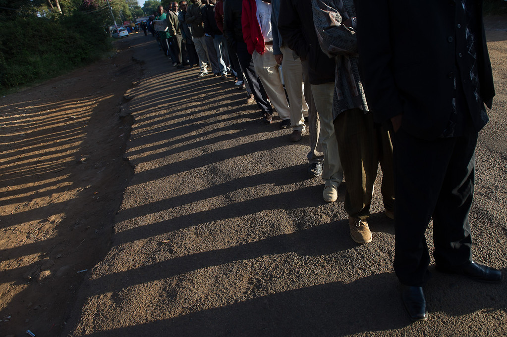 . Voters queue to cast their ballot at St. Matthews church in the Langata constituency of the Kenyan capital, Nairobi, on March 4, 2013 during the elections. Long lines of Kenyans queued from far before dawn to vote Monday in the first election since the violence-racked polls five years ago, with a deadly police ambush hours before polling started marring the key ballot. The tense elections are seen as a crucial test for Kenya, with leaders vowing to avoid a repeat of the bloody 2007-8 post-poll violence in which over 1,100 people were killed, with observers repeatedly warning of the risk of renewed conflict .     PHIL MOORE/AFP/Getty Images