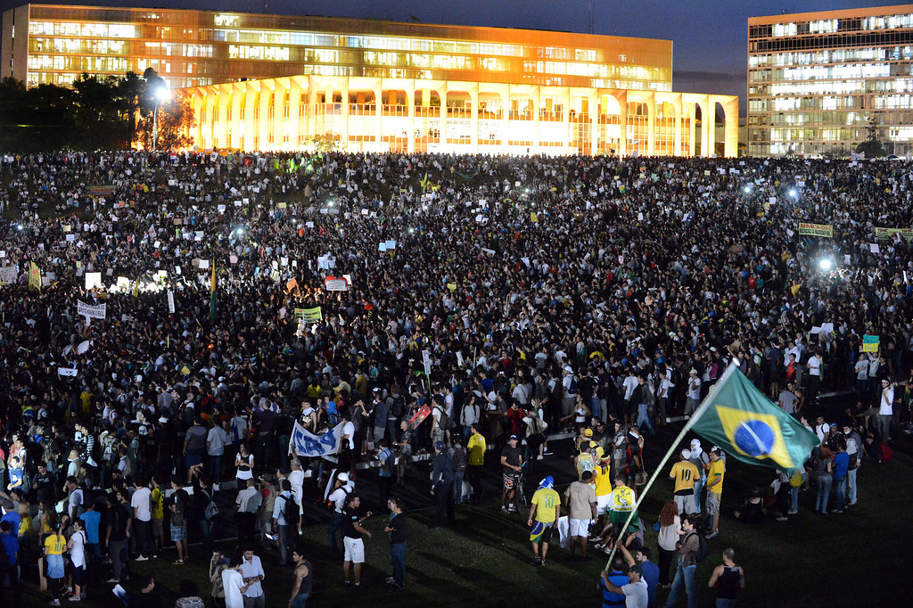 . Thousands of students shout slogans during a protest of what is now called the \'Tropical Spring\' against corruption and price hikes, at National Congress in Brasilia, on June 20, 2013.  AFP PHOTO / Evaristo SA/AFP/Getty Images