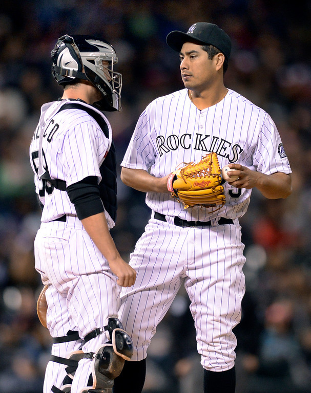 . DENVER, CO - MAY 15: Rockies catcher Jordan Pacheco came out mound after De La Rosa gave up a hit in the seventh inning. The Colorado Rockies hosted the San Diego Padres at Coors Field  Friday night, May 16, 2014. (Photo by Karl Gehring/The Denver Post)