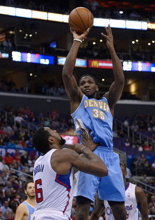 . Denver#35 Kenneth Faried shoots over Clippers#6 DeAndre Jordan. The Los Angeles Clippers defeated Denver Nuggets 117 to 105 in a regular season NBA game. Los Angeles, CA. 4/15/2014(Photo by John McCoy / Los Angeles Daily News)