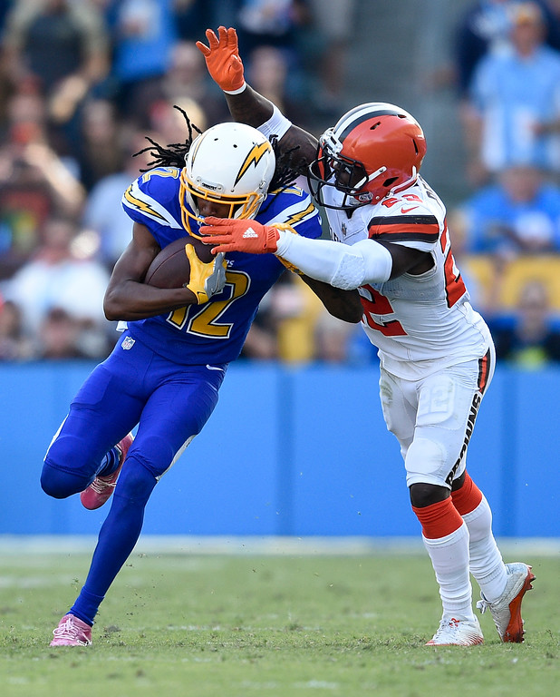 . Los Angeles Chargers wide receiver Travis Benjamin, is tackled by Cleveland Browns free safety Jabrill Peppers during the first half of an NFL football game Sunday, Dec. 3, 2017, in Carson, Calif. (AP Photo/Kelvin Kuo)