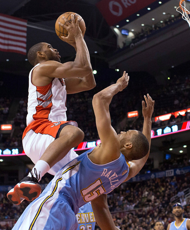 . Toronto Raptors\' Alan Anderson shoots over Denver Nuggets\' Anthny Randolph during the second half of an NBA basketball game in Toronto on Tuesday, Feb. 12, 2013. (AP Photo/The Canadian Press, Chris Young)