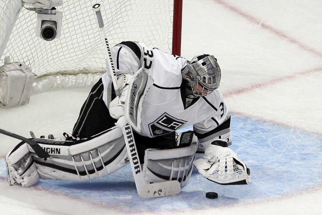 . Jonathan Quick #32 of the Los Angeles Kings makes a save against the Chicago Blackhawks during Game Five of the Western Conference Final in the 2014 Stanley Cup Playoffs at United Center on May 28, 2014 in Chicago, Illinois.  (Photo by Tasos Katopodis/Getty Images)