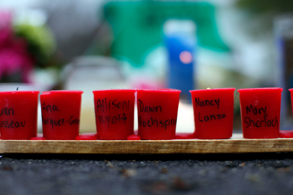 . Candles with the names of shooting victims written on them sit at a memorial near Sandy Hook Elementary School, Sunday, Dec. 16, 2012 in Newtown, Conn.  A gunman walked into Sandy Hook Elementary School in Newtown Friday and opened fire, killing 26 people, including 20 children. (AP Photo/Jason DeCrow)