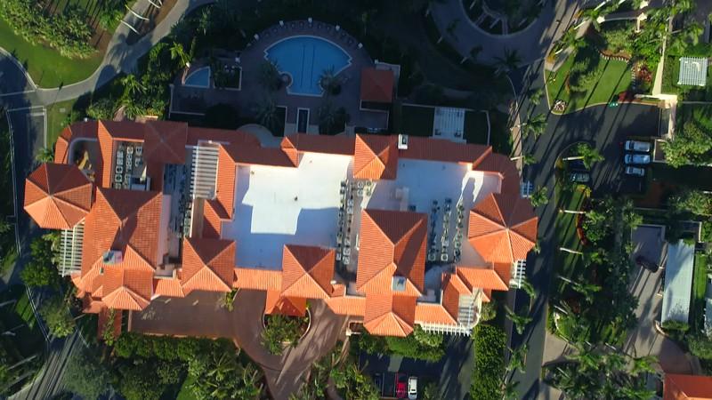 Aerial flyover condo reveal golf course landscape