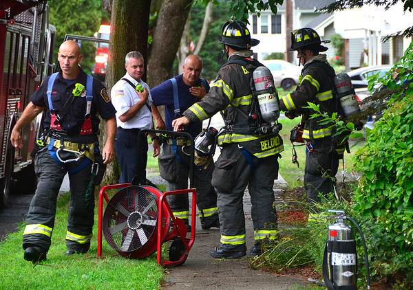 7/25/2018 Mike Orazzi | Staff Bristol firefighters while responding to a food on a stove call on Grove Street in Bristol Wednesday afternoon.
