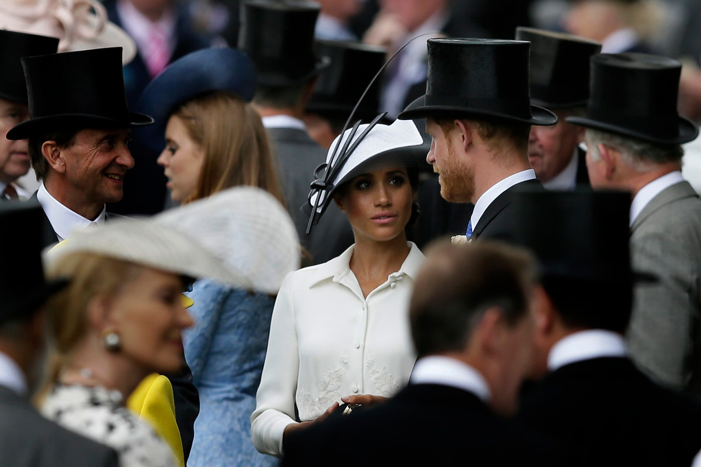 . Britain\'s Prince Harry and Meghan, Duchess of Sussex, arrive on the first day of the Royal Ascot horse race meeting in Ascot, England, Tuesday, June 19, 2018. (AP Photo/Tim Ireland)