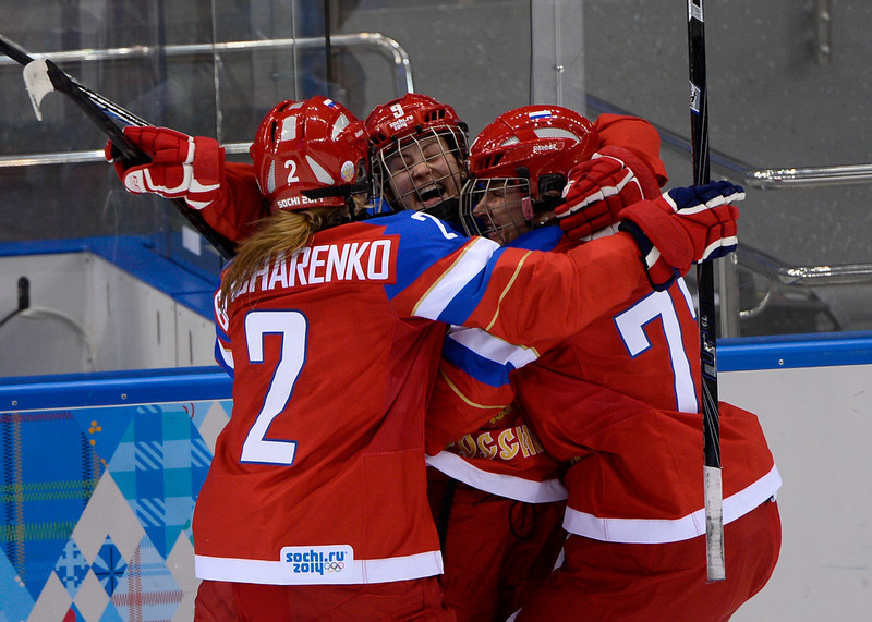 . Russia\'s Alexandra Vafina (C) celebrates after scoring during the Women\'s Ice Hockey Group B match Russia vs Japan at the Shayba Arena during the Sochi Winter Olympics on February 11, 2014. Russia won the game with the score 2-1. (JONATHAN NACKSTRAND/AFP/Getty Images)