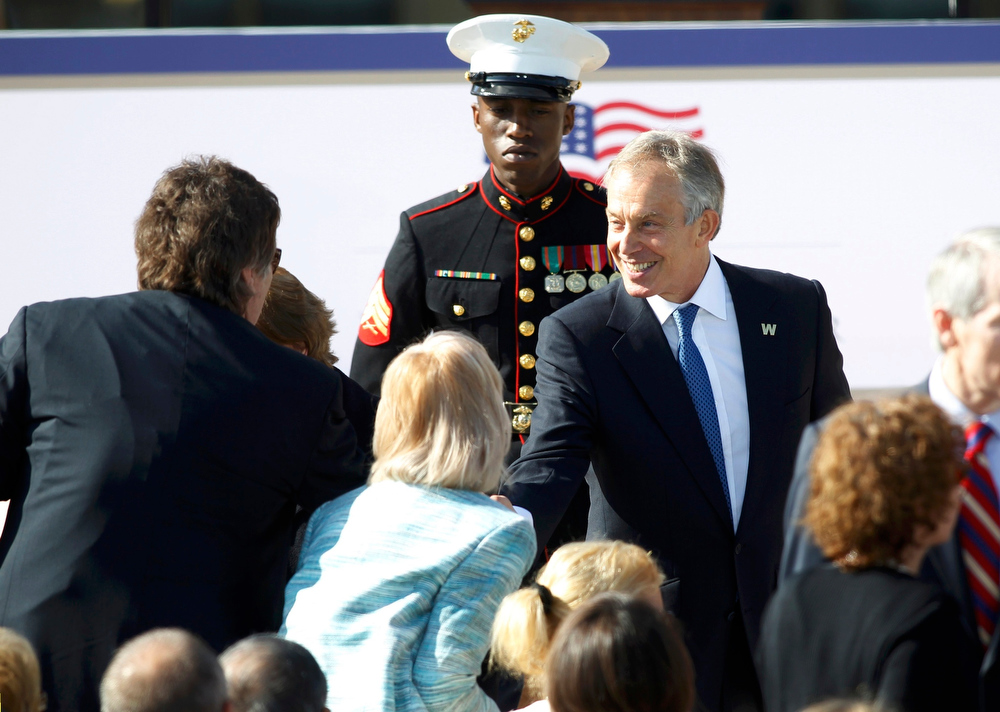 . Former British Prime Minister Tony Blair (R) shakes hands in the crowd as he arrives at the dedication for he George W. Bush Presidential Center on the campus of Southern Methodist University in Dallas, Texas April 25, 2013. REUTERS/Mike Stone