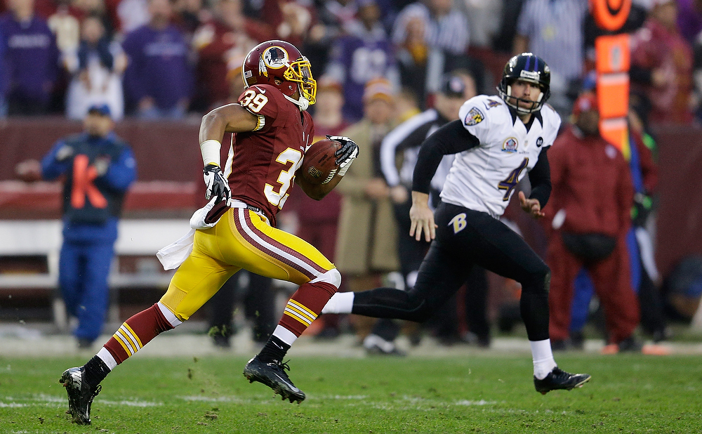 Description of . LANDOVER, MD - DECEMBER 09: Punter Sam Koch #4 of the Baltimore Ravens moves in to tackle  Richard Crawford #39 of the Washington Redskins on a punt return in overtime of the Redskins 31-28 win at FedExField on December 9, 2012 in Landover, Maryland.  (Photo by Rob Carr/Getty Images)