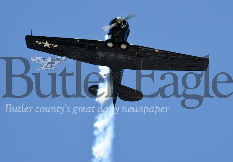 Harold Aughton/Butler Eagle: The Harrisville Memorial Day Parade began with a flyover by a vintage aircraft from WW II.