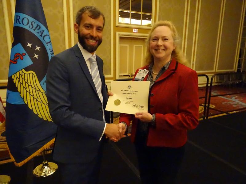 The AsMA International Aerospace Medicine Scholarship Award is present to Matt Wilkes by AsMA President, Dr. Valerie Martindale.