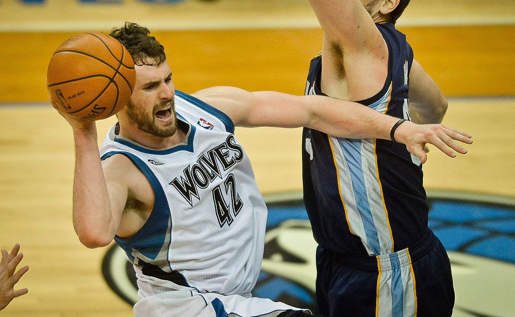 . Minnesota Timberwolves power forward Kevin Love reacts after hurting his ankle in the first half. Despite his injury he outscored the Grizzlies 18-16 in the third quarter as the Wolves scored 30 and erased a 13-point halftime deficit. He finished with 28 points and 16 rebounds. (Pioneer Press: Ben Garvin)