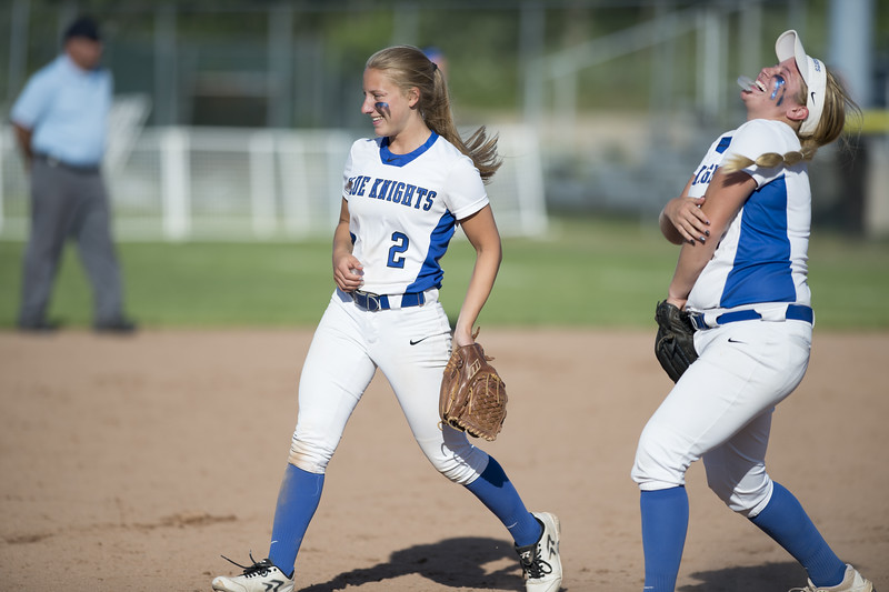 06/03/19  Wesley Bunnell | Staff  Southington softball defeated Trumbull in a semifinal Class LL game at DeLuca Field in Stratford on Monday afternoon. Chrisala Marotto (2) jokes with Abby Lamson (17) between innings.
