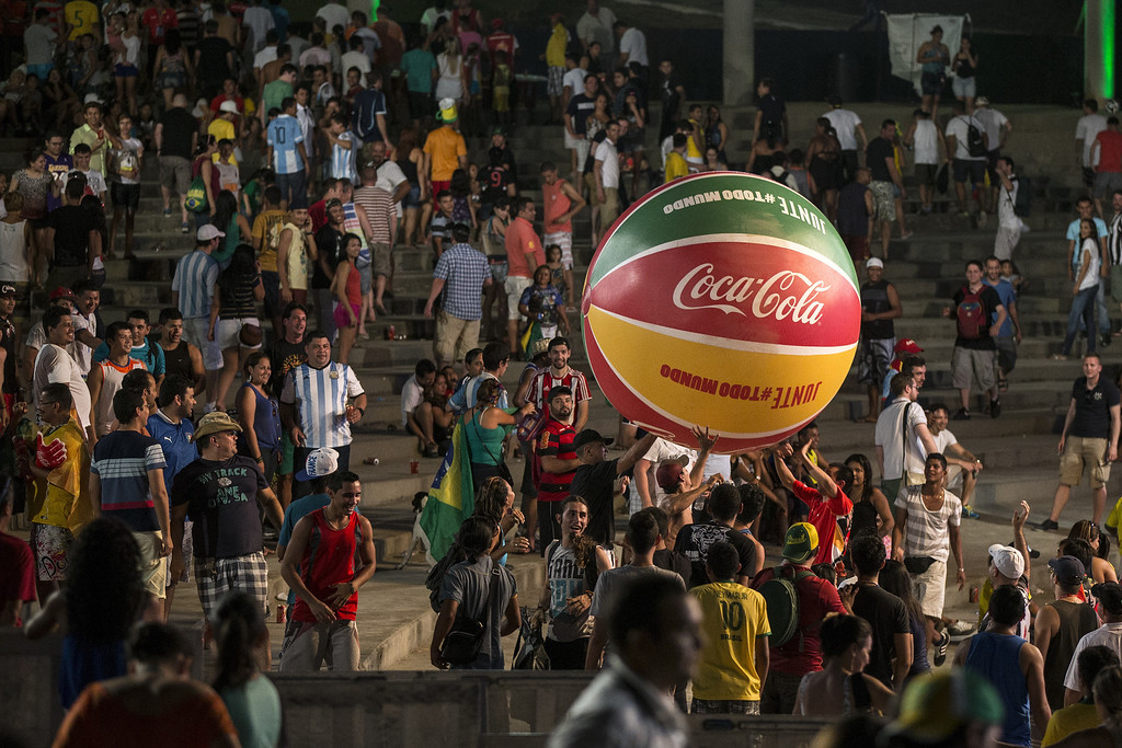 . Football fans play with a giant beachball after watching the FIFA World Cup group match between Argentina and Bosnia Herzegovina in the \'Fan Fest\' area in Ponta Negra on June 15, 2014 in Manaus, Brazil. Group D teams, England lost 2-1 to Italy in their opening match of the 2014 FIFA World Cup in Manaus on June 14, 2014.  (Photo by Oli Scarff/Getty Images)
