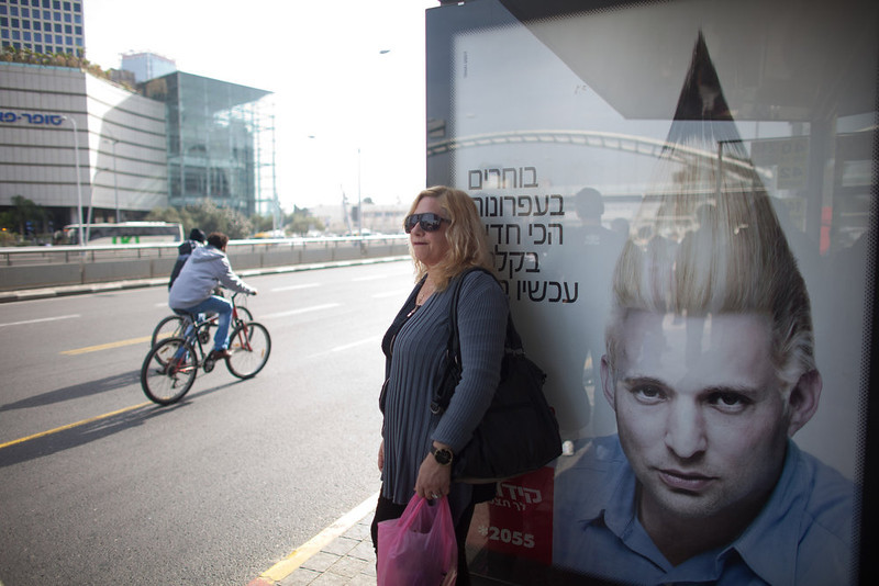 . A commercial poster for an Israeli school with the manipulated image Naftali Bennett, Head of HaBayit HaYehudi Party, or the Jewish Home party, hangs on a bus stop ahead of the upcoming Israeli elections on January 18, 2013 in Tel Aviv, Israel. Israeli elections are scheduled for January 22 and so far showing a majority for the Israeli right. (Photo by Uriel Sinai/Getty Images) (Photo by Uriel Sinai/Getty Images)