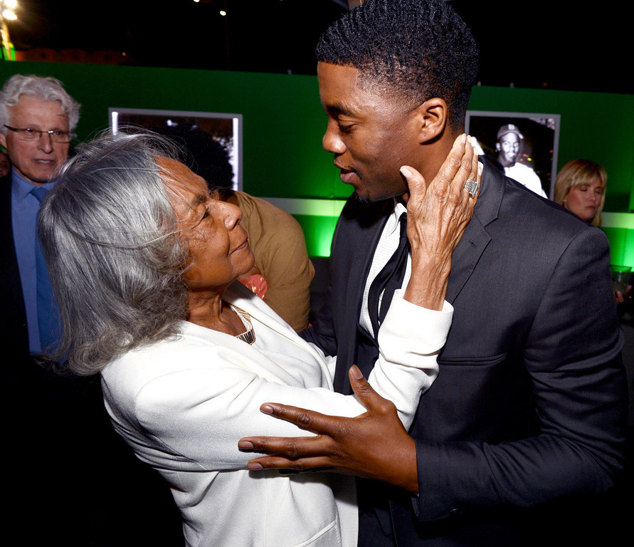 """. Jackie Robinson\'s widow Rachel Robinson (L) actor Chadwick Boseman appear at the after party for the premiere of Warner Bros. Pictures\' and Legendary Pictures\' \""""42\"""" at the Chinese Theatre on April 9, 2013 in Los Angeles, California.  (Photo by Kevin Winter/Getty Images)"""