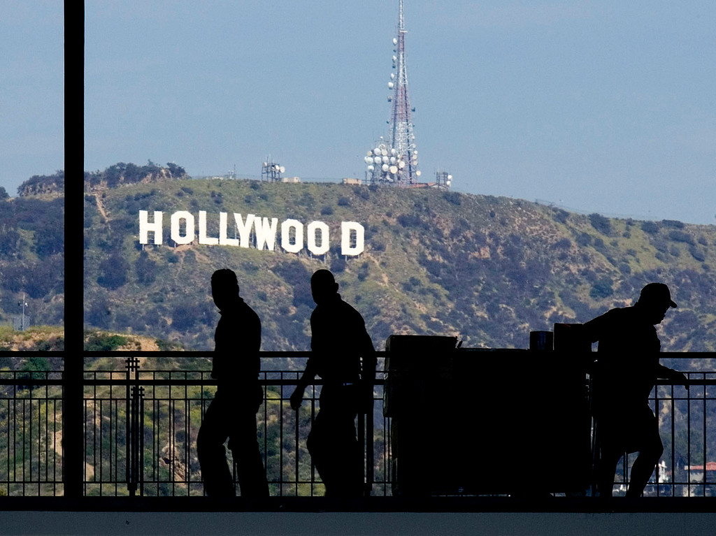 . The famous Hollywood sign is visible on Mount Lee is visible from a mall in  Los Angeles,in this March 18, 2008 photo. Potential sale of property on Cahuenga Peak near the sign has raised objections from many people and is forcing the city to consider buying the property. (AP Photo/Don Ryan)