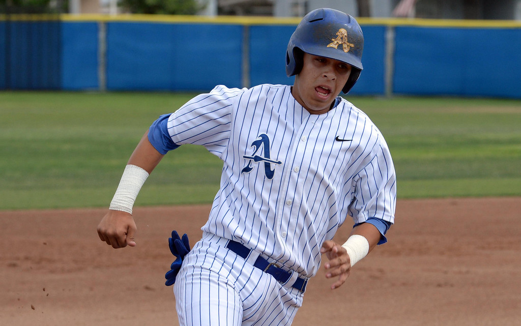 . Bishop Amat\'s Adryan Ramirez moves to third base on a RBI single by Michael Palos (pictured) in the first inning of prep baseball game against La Salle at Bishop Amat High School in La Puente, Calif., on Tuesday, May 6, 2014. (Keith Birmingham Pasadena Star-News)