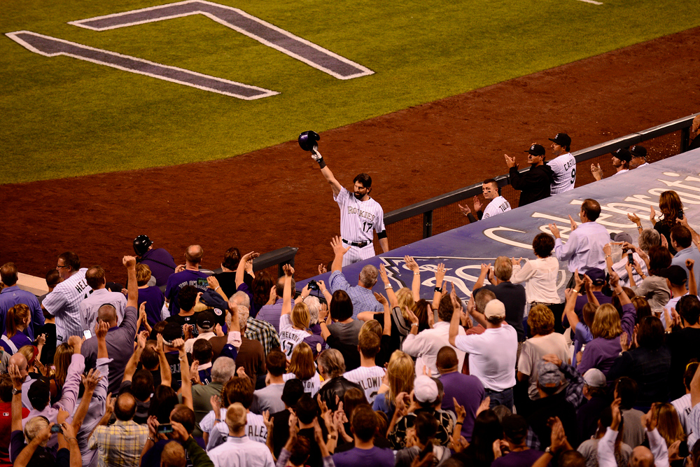 Description of . DENVER, CO - SEPTEMBER 25: Colorado Rockies legend Todd Helton tips his cap to the crowd after hitting career home run 369 off of Boston Red Sox starting pitcher Jake Peavy during his first at-bat of his final game game at Coors Field. The Colorado Rockies hosted the Boston Red Sox and said farewell to longtime first baseman Todd Helton, who recently announced his retirement following this season. Growing up, I loved looking at my dad's Sports Illustrated collection and was in awe of images that defined an athlete. For the past few years, I have worked alongside legendary Post sports photographer John Leyba and have looked through many of his defining moments in sports history -- Elway's Super Bowl wins, Todd Helton's World Series berth. On this day, Leyba asked me to second shoot the Rockies-Red Sox game, in addition to editing our images from the press box after the first inning to get them in by deadline. During the edit, I heard Helton's name announced for his first at-bat. I grabbed a camera and parked myself near the open windows on press row. He jacked one and I got to see it from a nice angle. It was a good day for Helton and the Rockies faithful.(Photo by AAron Ontiveroz/The Denver Post)