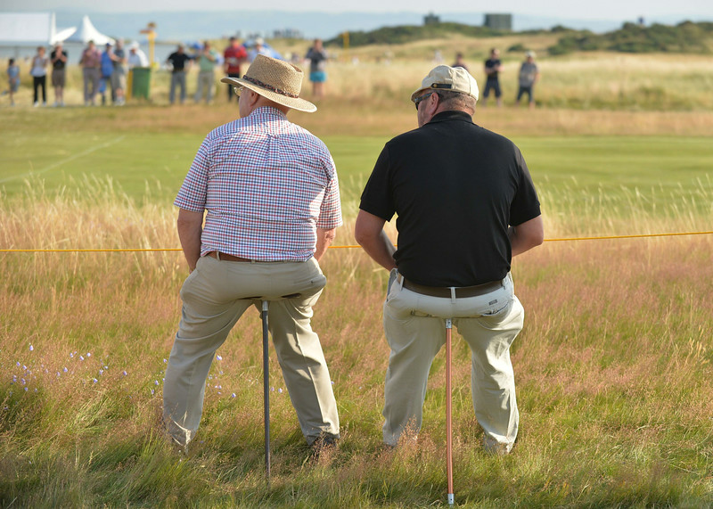 . Spectators watch play from beside the 17th fairway on the opening day of the 2014 British Open Golf Championship at Royal Liverpool Golf Course in Hoylake, north west England on July 17, 2014. (PAUL ELLIS/AFP/Getty Images)