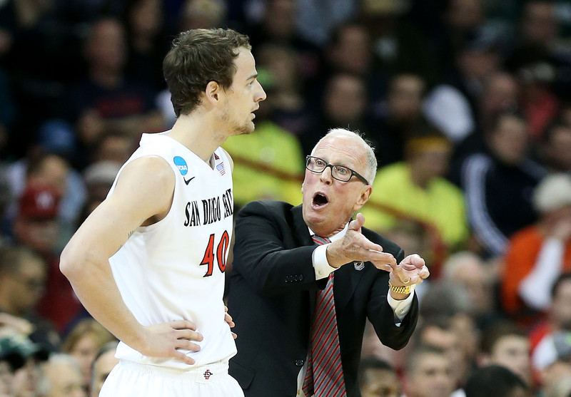 . Head coach Steve Fisher talks to Matt Shrigley #40 of the San Diego State Aztecs in the second half against the North Dakota State Bison during the Third Round of the 2014 NCAA Basketball Tournament at Spokane Veterans Memorial Arena on March 22, 2014 in Spokane, Washington.  (Photo by Stephen Dunn/Getty Images)