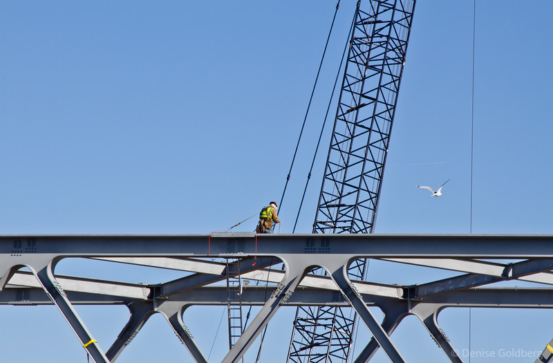 working high, on the Portsmouth span of the new Memorial Bridge