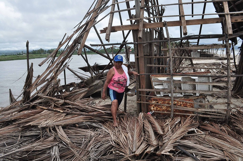 . A resident of Barra de Coyuca checks the destruction in a restaurant by the beach in a tourist resort close to Acapulco, Guerrero state, Mexico  on September 19, 2013 as heavy rains hit the country.  AFP PHOTO/ Claudio VARGAS/AFP/Getty Images