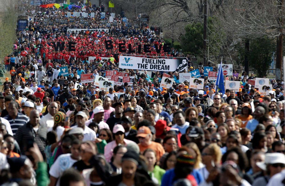 . Thousands take part in a march honoring Martin Luther King Jr., Monday, Jan. 21, 2013, in San Antonio. (AP Photo/Eric Gay)