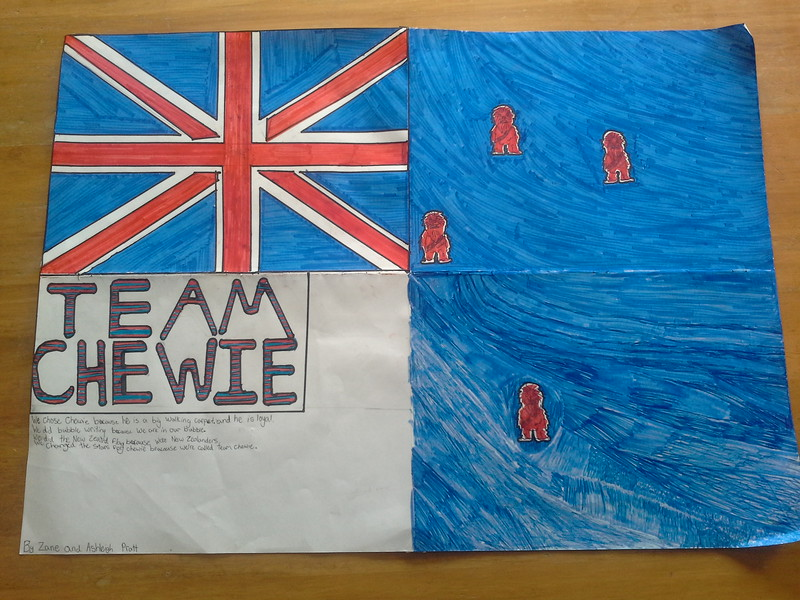 We chose Chewie because he is a big walking carpet and he is loyal. We did bubble writing because we are in our bubble. We did the New Zealand flag because we're New Zealanders.  We changed the stars for Chewie because we're called team chewie.