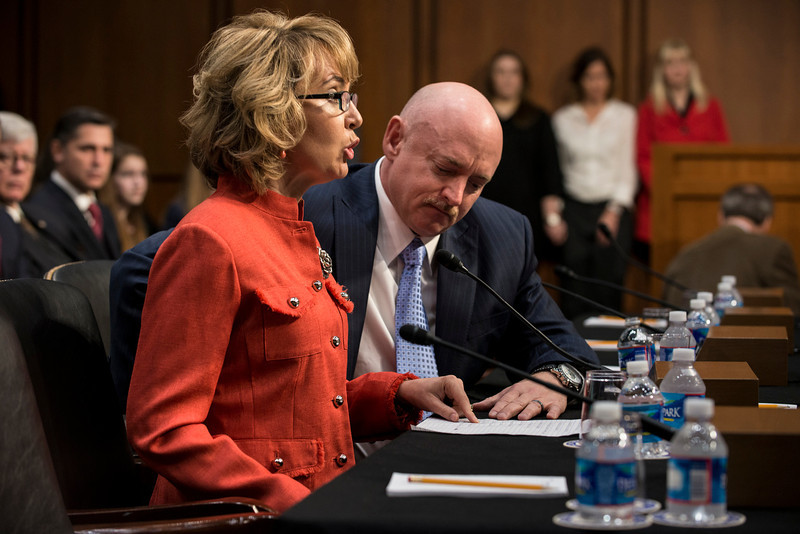 . Retired Astronaut Mark Kelly, husband of former Rep. Gabrielle Giffords,  listens as his wife shooting victim, former Rep. Gabrielle Giffords,as she makes a statement during a hearing of the Senate Judiciary Committee on Capitol Hill January 30, 2013 in Washington, DC. The committee held the hearing with Mark Kelly, Wayne LaPierre, Chief Executive Officer of the National Rifle Association, and others to testify about solutions to gin violence in the United States.  BRENDAN SMIALOWSKI/AFP/Getty Images