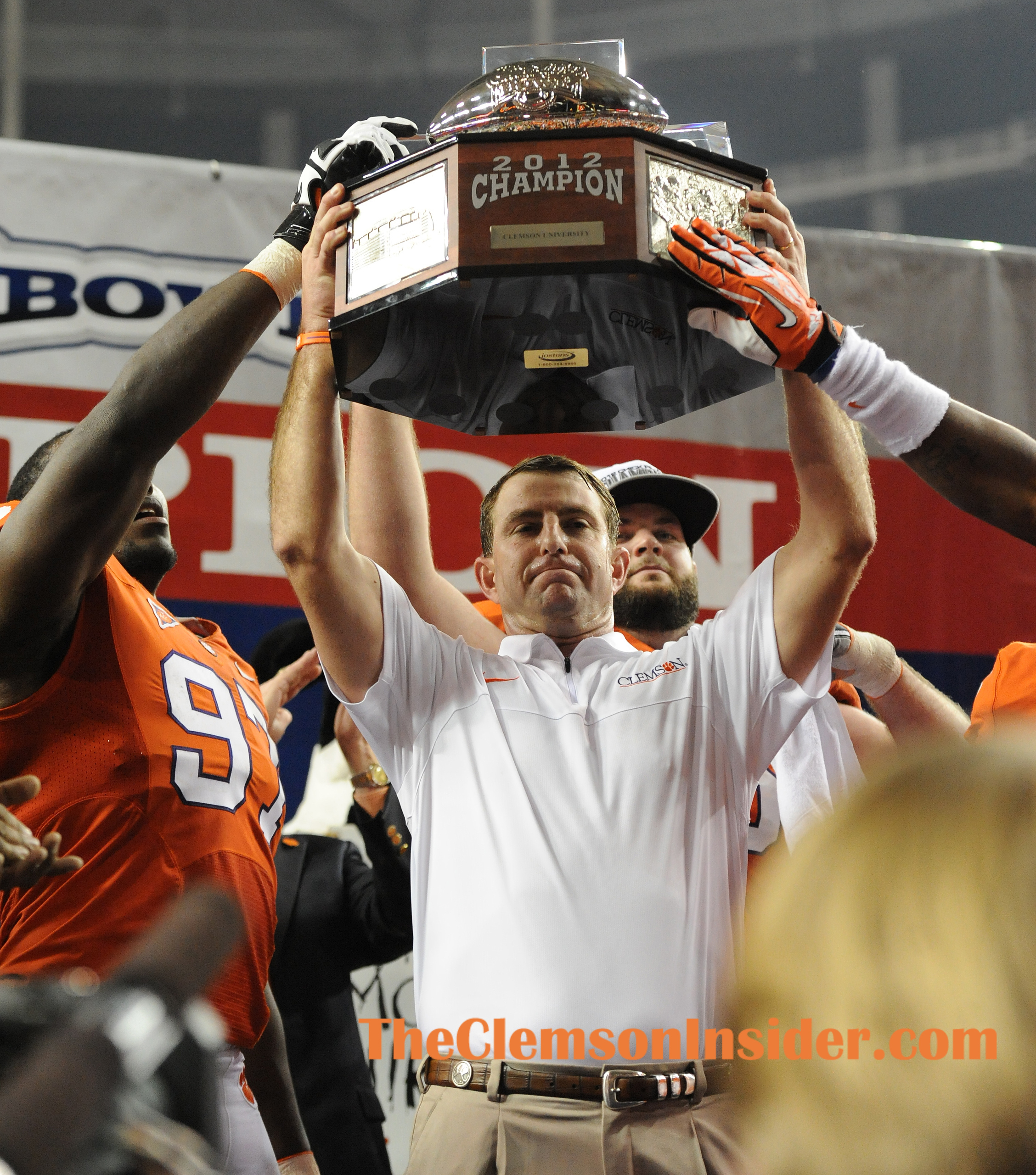 Clemson head coach Dabo Swinney holds the Chick-fil-A Bowl trophy after the Tigers defeated LSU 25-24 Monday, December 31, 2012 in the Georgia Dome in Atlanta. BART BOATWRIGHT/Staff