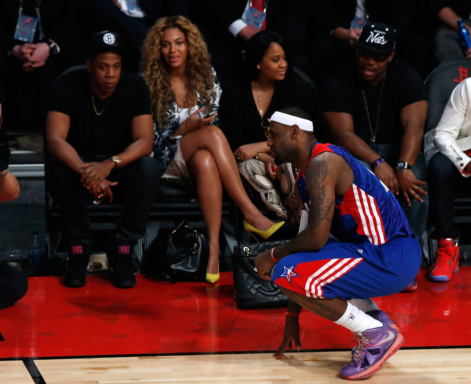 . Rapper Jay-Z and Beyonce look over at LeBron James #6 of the Miami Heat and the Eastern Conference during the 2013 NBA All-Star game at the Toyota Center on February 17, 2013 in Houston, Texas.   (Photo by Scott Halleran/Getty Images)