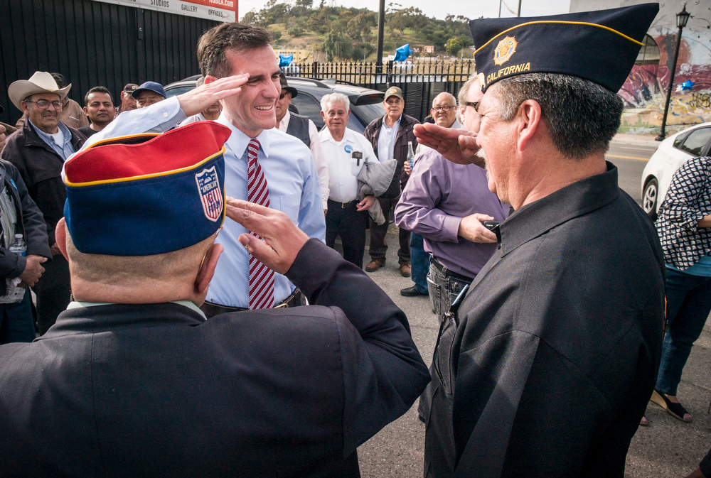 . Eric Garcetti salutes veteran supporters at a campaign stop in Los Angeles Sunday.  Garcetti is running for Los Angeles mayor.  The election is Tuesday.   Photo by David Crane/Staff Photographer