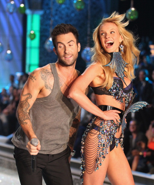 . NEW YORK, NY - NOVEMBER 09:  Adam Levine of Maroon 5 with model Anne V on the runway during the 2011 Victoria\'s Secret Fashion Show at the Lexington Avenue Armory on November 9, 2011 in New York City.  (Photo by Kevin Kane/FilmMagic)