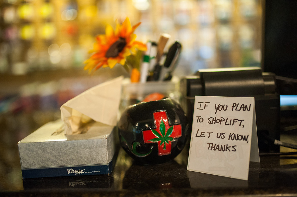 . A sign requests that would-be shoplifters identify themselves on a small sign seen here in the at Ganja Gourmet in Denver, Colorado, on April 17, 2013.  (Dustin Bradford/MCT)