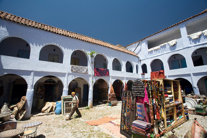 Carpets for sale on a courtyard, Chefchaouen, Morocco