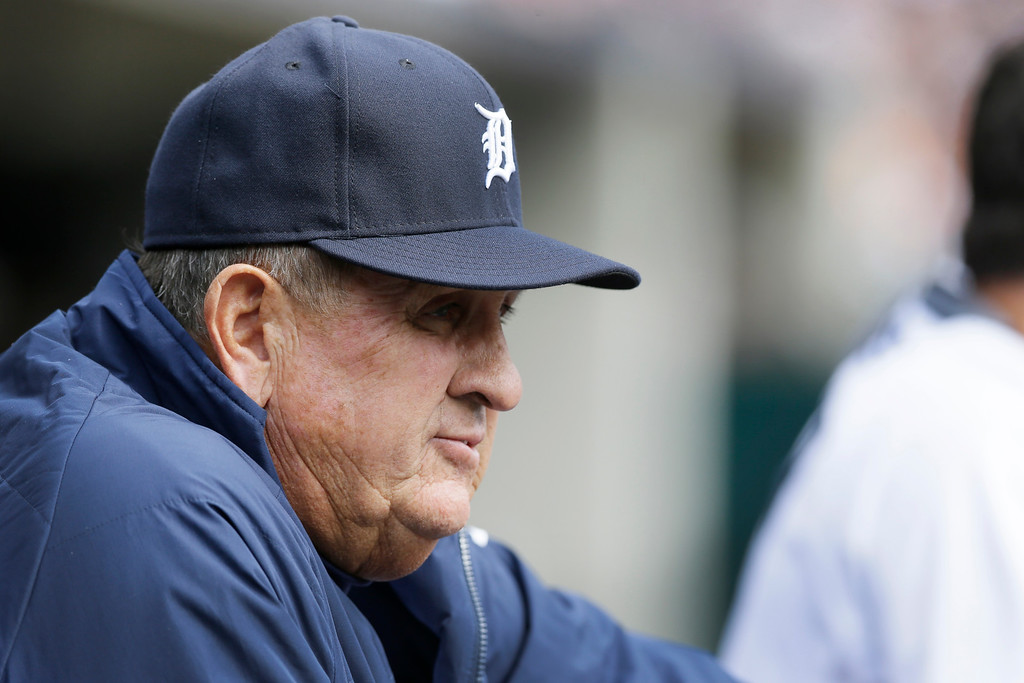 . Detroit Tigers bench coach Gene Lamont is seen in the dugout during the eighth inning of an opening day baseball game against the Minnesota Twins in Detroit, Monday, April 6, 2015. (AP Photo/Carlos Osorio)