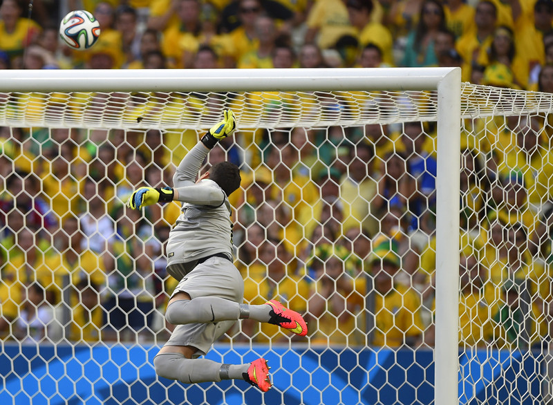 . Brazil\'s goalkeeper Julio Cesar jumps for the ball during a Group A football match between Brazil and Mexico in the Castelao Stadium in Fortaleza during the 2014 FIFA World Cup on June 17, 2014.  (ODD ANDERSEN/AFP/Getty Images)